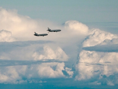 A flight of KC-10 Extender aerial refueling tankers with the 32nd Air Refueling Squadron at Joint Base McGuire-Dix-Lakehurst in NJ, practice refueling while flying over international airspace between Greenland and Canada in the arctic on Sunday, July 31, 2016. This was part of Operation Arctic Roar, a U.S. Strategic Command operation designed to strengthen bomber crews' interoperability and demonstrate ability for the U.S. bomber force to provide flexible and vigilant long-range global-strike capability. Earlier in the flight, they had refueled a formation of B-52 bombers.(Alan Lessig/Staff)