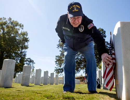 Wilbourne Markham reads his twin brother's headstone in the Chattanooga National Cemetery on Oct. 17, 2019, in Chattanooga, Tenn. (C.B. Schmelter/Chattanooga Times Free Press via AP)