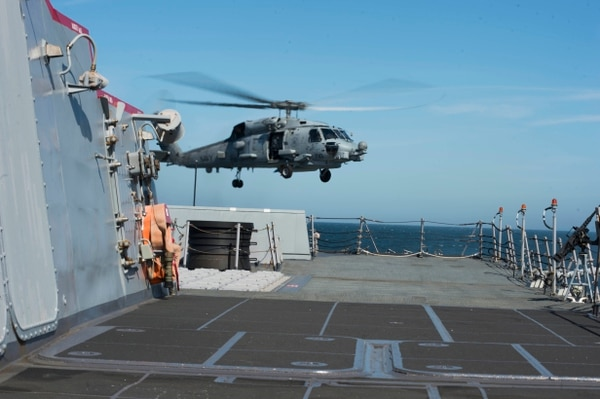 An U.S. Navy MH-60R Seahawk helicopter assigned to Helicopter Maritime Strike Squadron (HSM) 72 lifts off the flight deck of the guided missile destroyer USS Oscar Austin (DDG 79) in the Baltic Sea June 12, 2014, during flight quarters as part of Baltic Operations (BALTOPS) 2014. BALTOPS is a joint and combined exercise designed to enhance multinational maritime capabilities and interoperability between the U.S. and European nations in the Baltic region. (U.S. Navy photo by Mass Communication Specialist 3rd Class D.J. Revell/Released)