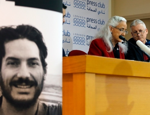 Marc and Debra Tice, the parents of Austin Tice, who is missing in Syria, speak during a press conference at the Press Club, in Beirut, Lebanon, Dec. 4, 2018. (AP Photo/Bilal Hussein)