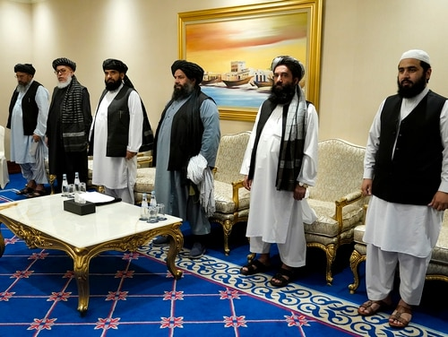 Members of the Taliban's peace negotiation team meet with Secretary of State Mike Pompeo amid talks between the Taliban and the Afghan government on Nov. 21, 2020, in Doha, Qatar. (Patrick Semansky/Pool via AP)