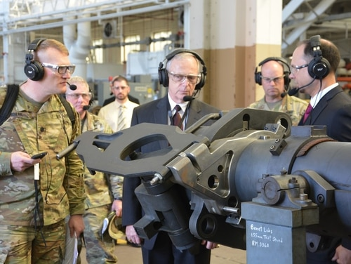 Bruce Jette (center), assistant secretary of the Army for acquisition, logistics and technology, gets a briefing on product improvements for cannon systems. (John Snyder/Army)