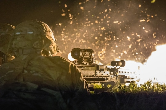 Soldiers return fire with the Squad Automatic Weapon during a joint forcible entry exercise at Kelly Drop Zone, San Antonio, Texas, on March 23, 2019. (Spc. Jeffery Harris/Army Reserve)