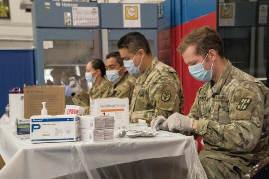 Soldiers prepare to administer the COVD-19 vaccine at Fort Hood, Texas, on Feb. 20. (Staff Sgt. Daniel Herman/Army)