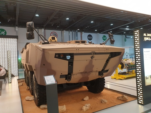 Sitting on top of an eight-wheel drive Rabdan infantry fighting vehicle at IDEX 2021 is Raytheon Technologies' High-Energy Laser Weapon System. (Agnes Helou/Staff)