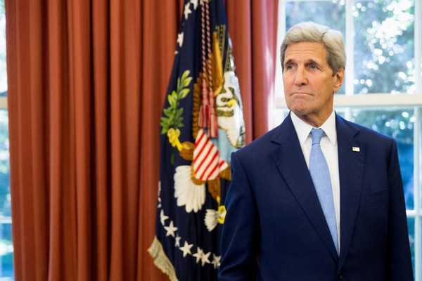 Secretary of State John Kerry is seen in the Oval Office of the White House in Washington, Tuesday, Sept. 15, 2015, as President Barack Obama and Spain's King Felipe VI conclude a bilateral meeting. (AP Photo/Andrew Harnik)