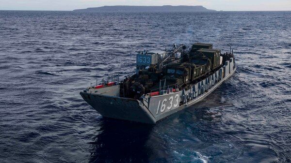 LCU 1633 departs the amphibious dock landing ship Ashland to ferry heavy equipment to Tinian in the Commonwealth of the Northern Mariana Islands. (Mass Communication Specialist 2nd Class Joshua Mortensen/Navy)