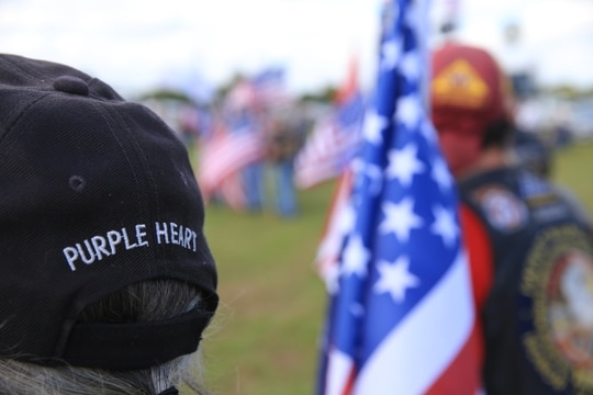 A wounded veteran listens during the dedication ceremony for the Cape Canaveral National Cemetery in Florida on Nov. 20, 2015. (VA photo)