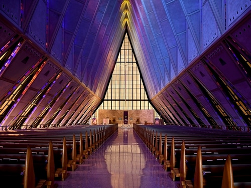 In this April 12, 2017, photo, light shines through the stained glass at the Cadet Chapel at the U.S. Air Force Academy outside Colorado Springs, Colo. The landmark Cadet Chapel is suffering from leaks and corrosion, so the school has drawn up the most ambitious restoration project in the building's 55-year history. (Thomas Peipert/AP)
