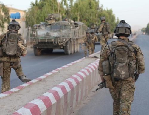 Members of the Afghan International Security Force patrol a street in Nad 'Ali District in Helmand province, Afghanistan, in June 2010. (Spc. Joseph Wilson/Army)