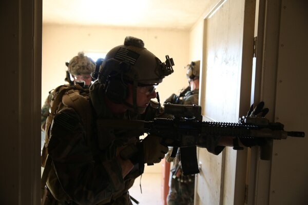 A critical skills operator with 2d Marine Raider Battalion, Marine Corps Forces, Special Operations Command, secures a doorway and hallway during training at Atlantic Airfield, North Carolina, in 2015. (Sgt. Donovan Lee/Marine Corps)