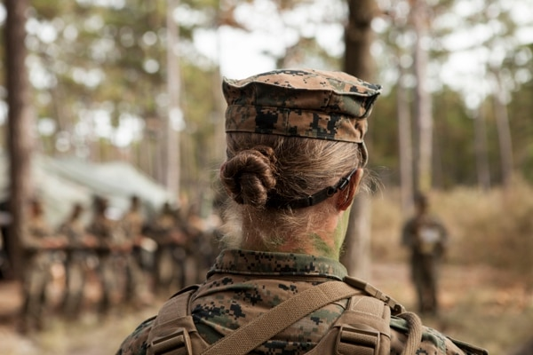 U.S. Marine Corps Private First Class Katie M. Gorz from Delta Company, Infantry Training Battalion (ITB), School of Infantry-East (SOI-E) receives final instructions prior to assaulting an objective during the Infantry Integrated Field Training Exercise aboard Camp Geiger, N.C., Nov 15, 2013. Delta company is the first company at ITB with female students as part of a measured, deliberate and responsible collection of data on the performance of female Marines when executing existing infantry tasks and training events, the Marine Corps is soliciting entry-level female Marine volunteers to attend the eight week basic infantryman and infantry rifleman training courses at ITB. (U. S. Marine Corps photo by Cpl. Maricela Veliz, Combat Camera, SOI-E/Released)