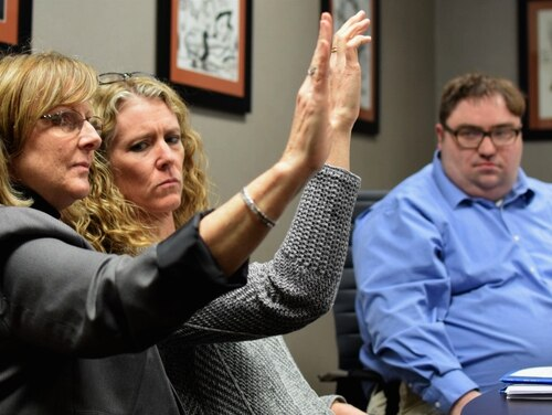 In accelerated resolution therapy, providers wave their hand as a patient thinks through the beginning, middle and end of a scene associated with their trauma. Here, Brenda Stutler, an ART trainer, teaches psychiatric nurse practitioners Shannon Ryan and Chris Bennett how to use the therapy in their practices. (Natalie Gross/Military Times)