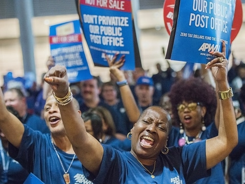 Nannette Corley, president of American Postal Workers Union Montgomery County Area Local, chants with other supporters during an APWU rally to protest the Trump administration's efforts to privatize the U.S. Postal Service. (Lake Fong/Pittsburgh Post-Gazette via AP)