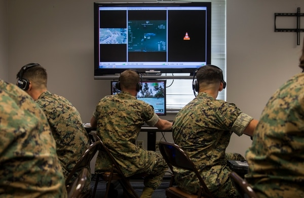 U.S. Marines with II Marine Expeditionary Force and 2nd Air Naval Gunfire Liaison Company conducts a mission on Virtual Battlespace 3, while receiving support from a Joint Terminal Attack Controller during Emerald Warrior, aboard Camp Lejeune, N.C., May 9, 2016. Simulation centers from Charleston Air Force Base, S.C., Eglin AFB, F.L., Cannon AFB, N.M. and Distributed Training Operations Center, I.A. all took part in Emerald Warrior providing various support assets vital to the JTACs mission of bringing the air element to the ground element. (U.S. Marine Corps photo by Cpl. Justin T. Updegraff/ Released)