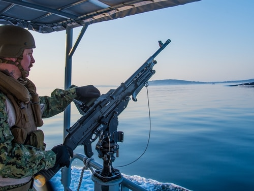 On Aug. 28, 2017, Engineman 1st Class Nathan Bootsma, a crewman gunner assigned to Coastal Riverine Squadron 11, High Value Unit Pacific Northwest, stood aft lookout on board a 34-foot Sea Arc patrol boat as it escorted the Seawolf-class fast-attack submarine Connecticut during its transit home to Naval Base Kitsap-Bremerton. (Chief Boatswain's Mate Nelson Doromal/Navy)
