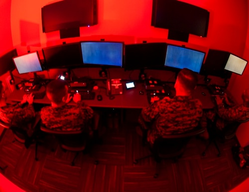 Marines with Marine Corps Forces Cyberspace Command pose for photos in the cyber operations room at Lasswell Hall aboard Fort Meade, Md., Feb. 5, 2020. (photo illustration by Staff Sgt. Jacob Osborne/Marine Corps)