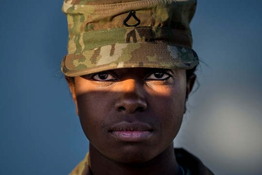 Pfc. Alexis Jones, a U.S. Army Reserve horizontal construction engineer with the 160th Military Police Battalion, headquartered in Tallahassee, Florida, from Winter Garden, Florida, looks into the camera for a sun-lit portrait during the 200th Military Police Command's Best Warrior Competition held at Fort Hunter Liggett, California, April 19, 2018. During the competition, Soldiers were tested both physically and mentally in events that include the Army Physical Fitness Test, land navigation, obstacle course, ruck marching, weapon qualification, Army Warrior Tasks, reflexive fire, written exams and the Army appearance board. Soldiers from the U.S. Army Reserve Legal Command also participated in the competition. The winning Soldiers will move on to compete in the U.S. Army Reserve Command competition later this year. (Master Sgt. Michel Sauret/Army)