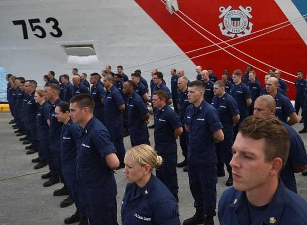 FORT LAUDERDALE, FL - DECEMBER 15: Some of the crew of the U.S. Coast Guard ship Hamilton stand at attention as they wait for the approximately 26.5 tons of cocaine to be offloaded at Port Everglades on December 15, 2016 in Fort Lauderdale, Florida. The drugs worth an estimated $715 million were from 27 separate, suspected drug smuggling vessel interdictions and five bale recovery operations by the U.S. Coast Guard, Royal Canadian Naval crews and its interagency partners. (Photo by Joe Raedle/Getty Images)