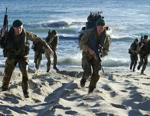 British soldiers land on Eastern Beach as they participate in a military exercise in Gibraltar on Dec. 9, 2014. A review by the government will aim to create a more coherent and strategic approach to