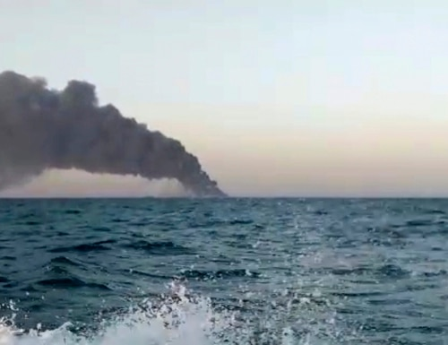This image made from a video released on June 2, 2021, by Asriran.com, shows smoke rising from Iran's navy support ship Kharg in the Gulf of Oman. (Asriran.com via AP)