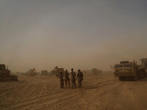 In this Nov. 6, 2017, photo, U.S. Marines prepare to build a military site during a sandstorm in western Anbar, Iraq. (Khalid Mohammed/AP)