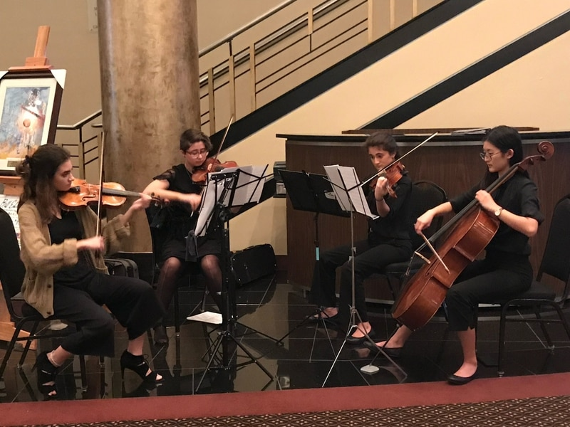 Eleanor David, second from right, playing in chamber ensemble. (Courtesy Operation Homefront)