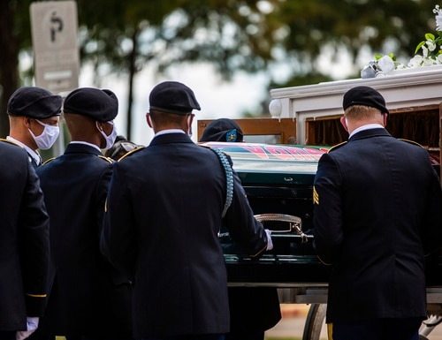 The casket of Army Spc. Vanessa Guillen is removed from a carriage to take it to a memorial service in honor of the soldier at Cesar Chavez High School Friday, Aug. 14, 2020, in Houston. (Marie D. De Jesus/Houston Chronicle via AP)