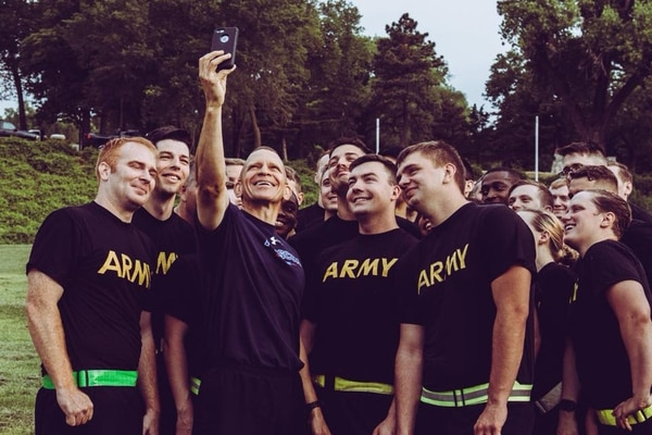 Sergeant Major of the Army Michael Grinston, shown when he was command sergeant major at Army Forces Command, takes a selfie with soldiers.