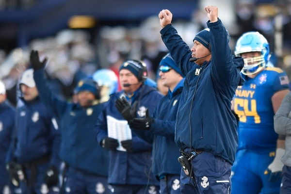 Navy head coach Ken Niumatalolo celebrates a touchdown against Virginia in the first half of the Military Bowl NCAA college football game, Thursday, Dec. 28, 2017, in Annapolis, Md. (Gail Burton/AP)