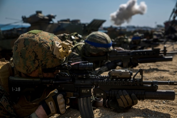 Cpl. Nicholas Hill, a joint fire observer from Manchester, Tenn., provides security as the amphibious assault vehicles as part of Exercise Ssang Yong 16, March 12, 2016. Ssang Yong 16 is a biennial combined amphibious exercise conducted by forward-deployed U.S. forces with the Republic of Korea Navy and Marine Corps, Australian Army and Royal New Zealand Army Forces in order to strengthen our interoperability and working relationships across a wide range of military operations - from disaster relief to complex expeditionary operations. Hill is part of 5th Naval Air Liaison Company.