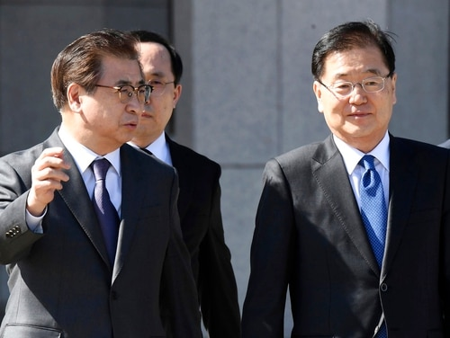 South Korea's national security director Chung Eui-yong, right, and National Intelligence Service Chief Suh Hoon, left, talk before boarding an aircraft as they leave for Pyongyang at a military airport in Seongnam, Monday, March 5, 2018. A group of high-level South Korean officials has left for North Korea for talks on North Korea's nuclear program and ways to help resume talks between Pyongyang and Washington. (Jung Yeon-je/Pool Photo via AP)