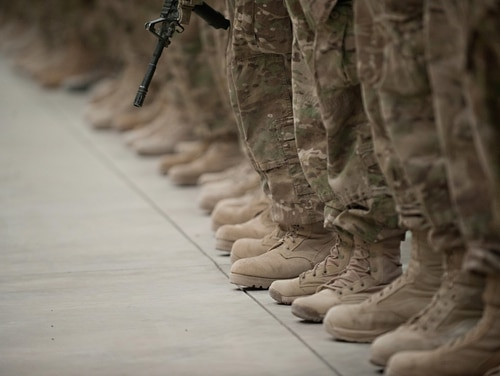 Soldiers stand in formation during an award and re-enlistment ceremony at Kandahar Airfield, Afghanistan. (Staff Sgt. Teddy Wade/Army)