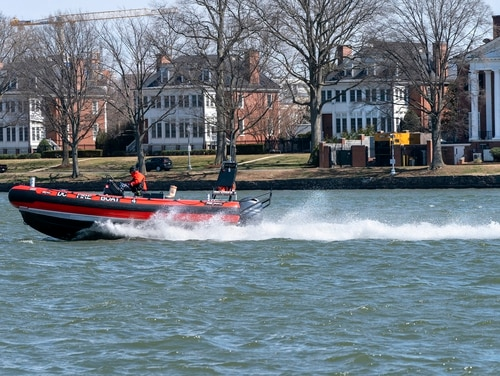 In this March 19, 2021, photo a District of Columbia Fire Boat checks buoys in the waterway next to Fort McNair, seen in background in Washington. (Jacquelyn Martin/AP)