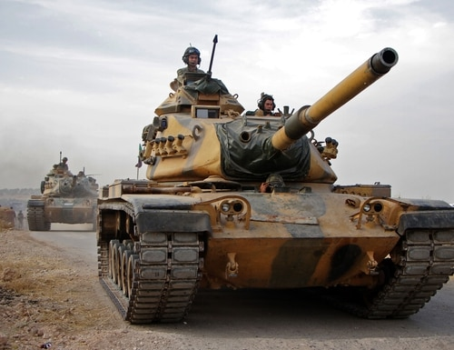 Turkish soldiers with U.S.-made M60 tanks drive through the town of Tukhar, north of Syria's northern city of Manbij, on Oct. 14, 2019, as Turkey and it's allies continues their assault on Kurdish-held border towns in northeastern Syria. (Aref Tammawi/AFP via Getty Images)
