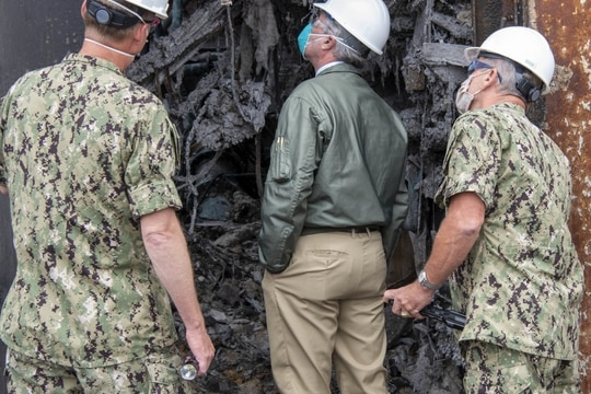 SAN DIEGO (July 27, 2020) Secretary of the Navy Kenneth J. Braithwaite tours fire damage aboard the amphibious assault ship Bonhomme Richard during a visit to the ship at Naval Base San Diego. (U.S. Navy photo by Mass Communication Specialist 1st Class Jason Kofonow)