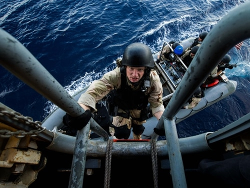151022-N-GR718-225 PACIFIC OCEAN (Oct. 22, 2015) Machinist's Mate 3rd Class Sterling Schlapak climbs up the pilot ladder as the visit, board, search, and seizure team (VBSS) returns to the amphibious transport dock ship USS New Orleans (LPD 18). New Orleans is part of the Boxer Amphibious Ready Group (ARG), composed of USS New Orleans, amphibious assault ship USS Boxer (LHD 4), dock landing ship USS Harpers Ferry (LSD 49), and the 13th Marine Expeditionary Unit, is conducting a Composite Training Unit Exercise to test their ability to effectively respond to scenario driven events and perform as integrated units in preparation for deployment . (U.S. Navy photo by Mass Communication Specialist Seaman Chelsea D. Daily/Released)