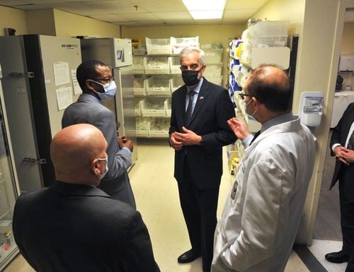 VA Secretary Denis McDonough tours a pharmacy storage area at the Washington, D.C., VA medical center while receiving a briefing from local officials about coronavirus protocols on Feb. 10. (Robert Turtil/Veterans Affairs)