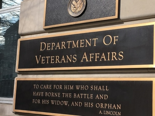 The Veterans Affairs motto displayed outside department headquarters is seen on Feb. 20, 2018. (Leo Shane III/Staff)