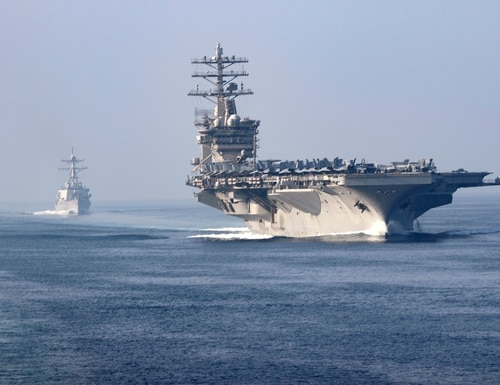 The aircraft carrier USS Nimitz (CVN 68), guided-missile destroyer USS John Paul Jones (DDG 53), center, and the guided-missile cruiser USS Princeton (CG 59) sail in formation during a scheduled transit of the Strait of Hormuz, Nov. 9, 2020. (MC3 Anthony Collier/Navy)