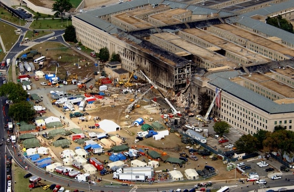 FBI agents, firefighters, rescue workers and engineers work at the Pentagon crash site on Sept. 14, 2001, where a hijacked American Airlines flight slammed into the building on Sept. 11. (Defense Department)