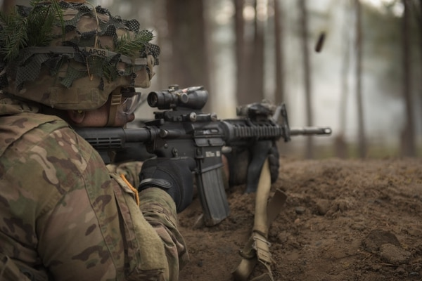 A soldier assigned to the 173rd Airborne Brigade fires an M4 during a company live-fire as part of exercise Eagle Strike at Grafenwoehr, Germany. (Staff Sgt. Alexander C. Henninger/Army)