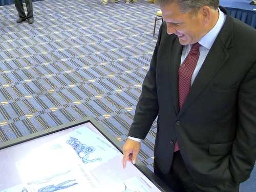 James Geurts, shown here on May 20, 2014, as deputy for acquisition of U.S. Special Operations Command, looks at sketches of the Tactical Assault Light Operator Suit during the Special Operations Forces Industry Conference in Tampa, Fla. (Tamara Lush/AP)