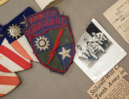 Memorabilia from the famed WWII Army unit Merrill's Marauders is is displayed on a table during a gathering of remaining members, family and history buffs, in New Orleans, Tuesday, Aug. 28, 2018. (Gerald Herbert/AP)