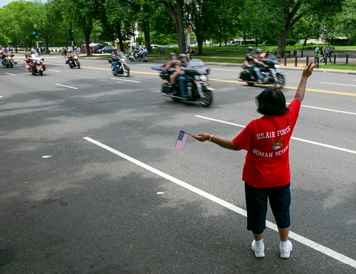 Air Force veteran Anna Sanders shows her support to riders during Rolling Thunder ride in Washington, D.C. on May 27, 2018. (Alan Lessig/Staff)