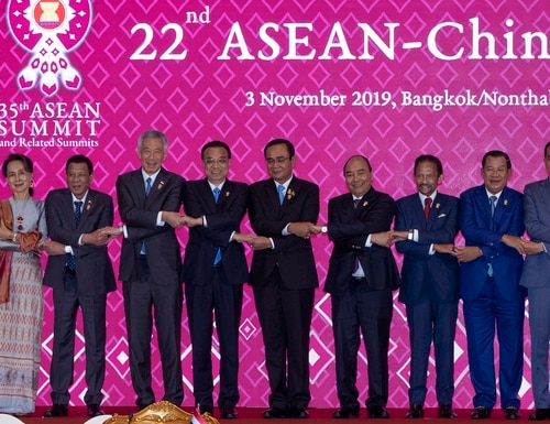 Chinese Premier Li Keqiang, fifth from left, shake hands with ASEAN leaders, from left, Malaysian Prime Minister Mahathir Mohamad, Myanmar State Counsellor Aung San Suu Kyi, Philippines President Rodrigo Duterte, Singapore Prime Minister Lee Hsien Loong, Thailand Prime Minister Prayuth Chan-ocha, Vietnam Prime Minister Nguyen Xuan Phuc, Brunei Sultan Hassanal Bolkiah, Cambodia Prime Minister Hun Sen, Indonesia President Joko Widodo, and Laos Prime Minister Thongloun Sisoulith during ASEAN-China summit in Nonthaburi, Thailand, on Sunday. (Gemunu Amarasinghe/AP)