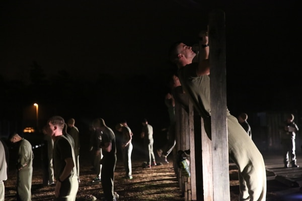 Marine perform pull-ups during Phase I of the U.S. Marine Corps Forces Special Operations Command's Assessment and Selection course aboard Marine Corps Base Camp Lejeune, N.C., Jan. 5, 2015. Completing a physical fitness test with a minimum score of 225 is a requirement to become a Critical Skills Operator with MARSOC.