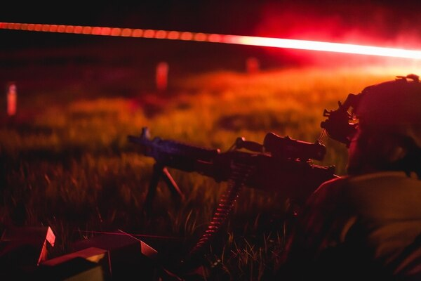 A Chile special forces soldier assists a U.S. SF soldier engage practice targets April 22, 2015, during night fire training in Camp Shelby, Miss., as part of a bilateral training exchange organized by members of Special Operations Command South. The training exchange promotes cooperation among peer nations as both countries share common concerns in the region regarding threats such as transnational organized crime and terrorism. (U.S. Army photo by Staff Sgt. Osvaldo Equite/Released)