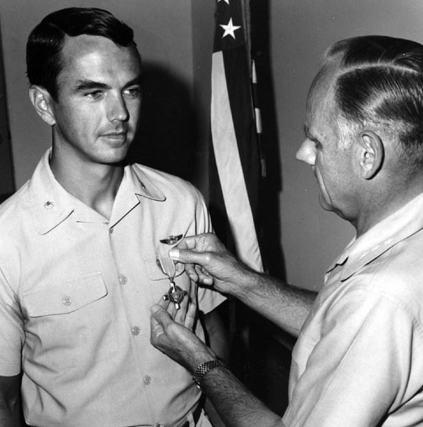 Col. Philip J. Conran receives an Air Force Cross for his heroic actions in Laos on Oct. 6, 1969. (Courtesy of the Robert F. Dorr Collection)