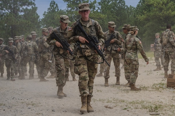 New recruits with 2nd Battalion, 13th Infantry Regiment at Fort Jackson, S.C., prepare for a land navigation course. (Spc. Jeremiah Woods/Army)